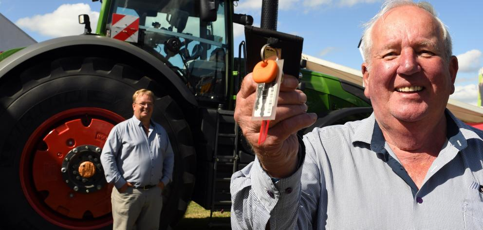 JJ Ltd managing director Dave Jones holds the key to  the world's largest conventional tractor,...