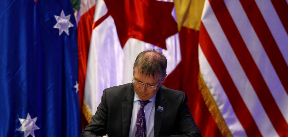 Trade and Export Growth Minister David Parker signing the CPTPP in Santiago yesterday. Photo:...