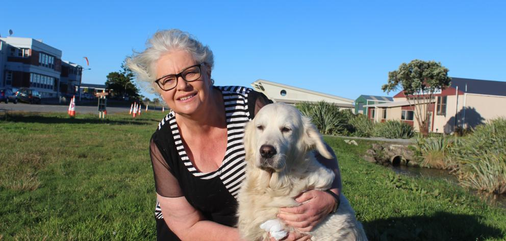 Bianca Kramer and her golden retriever Ava (9), who has returned after being missing for a week. Photo: Greymouth Star