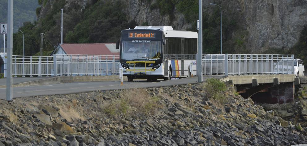 A Ritchies bus, on the Otago Peninsula route, passes a new temporary bus stop on the Andersons...