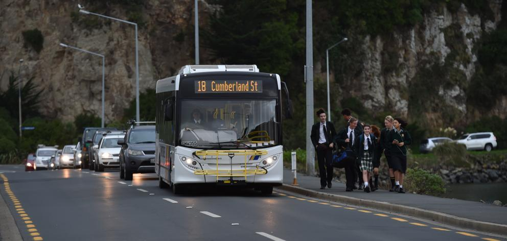 Bayfield High School pupils use the new temporary bus stop on the Andersons Bay causeway yesterday. Photo: Peter McIntosh