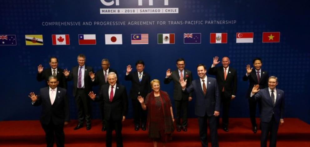 Members of Trans-Pacific Partnership trade deal pose for an official picture before the signing agreement ceremony in Santiago. Photo: Reuters