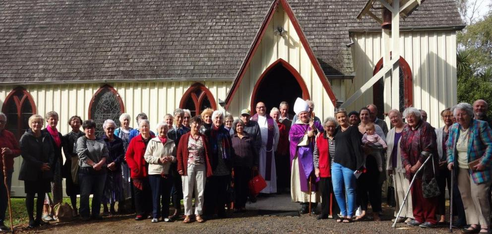 The Anglican Bishop of Dunedin, the Rt Rev Dr Steven Benford (at right of doorway) with St John's...
