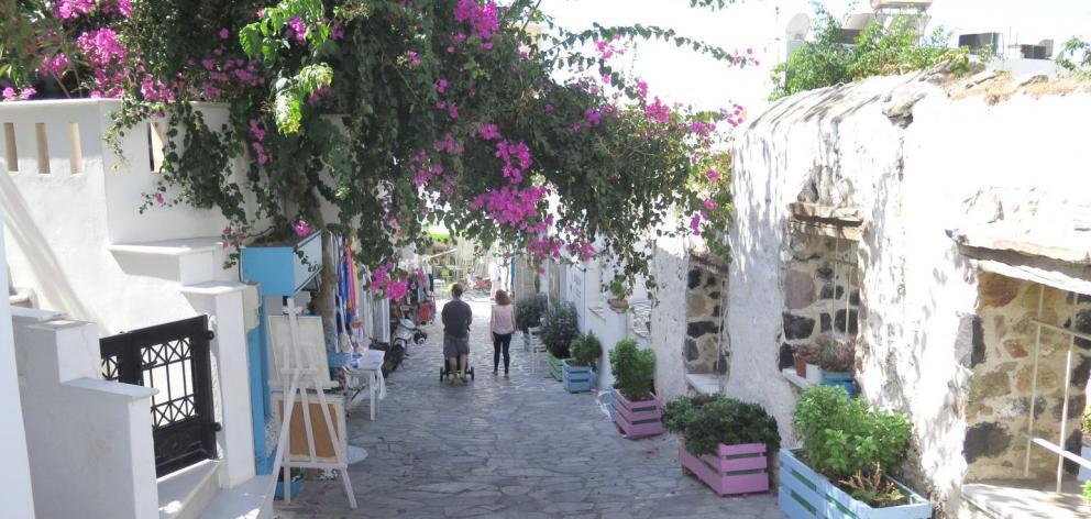 The bougainvillea-emblazoned village of Halki. PHOTO: MIKE YARDLEY