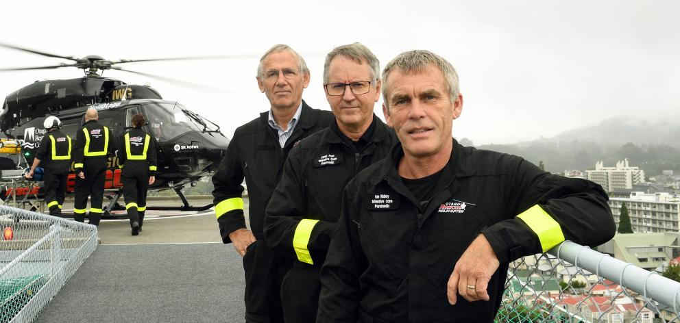 Twenty years on from the inaugural landing, crew (from left) Helicopters Otago chief pilot Graeme...
