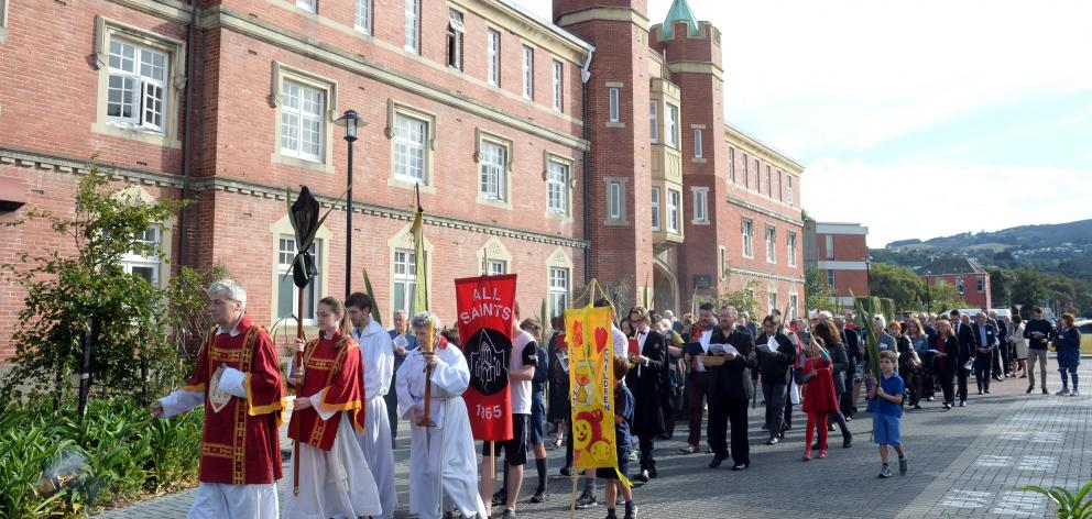Prof David Fielding, of the University of Otago, leads a procession from Selwyn College to a...