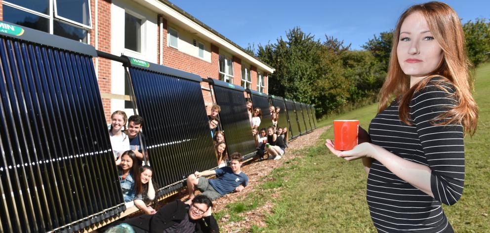 Aquinas College resident Alyssa Cruickshank  enjoys the sun beside the solar fence at Aquinas,...