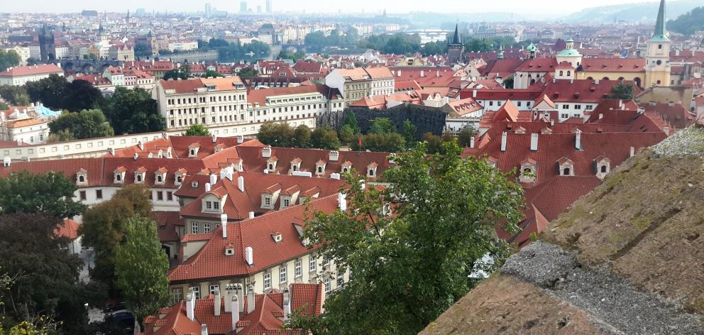 View of Prague from Prague Castle and the city's cathedral.