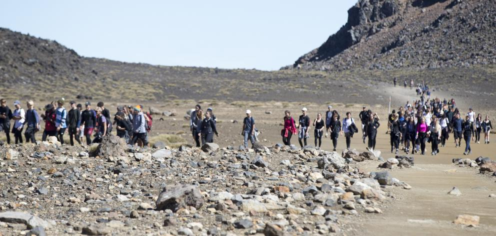 Visitors crowd the track in the southern crater of the Tongariro Crossing in February last year....