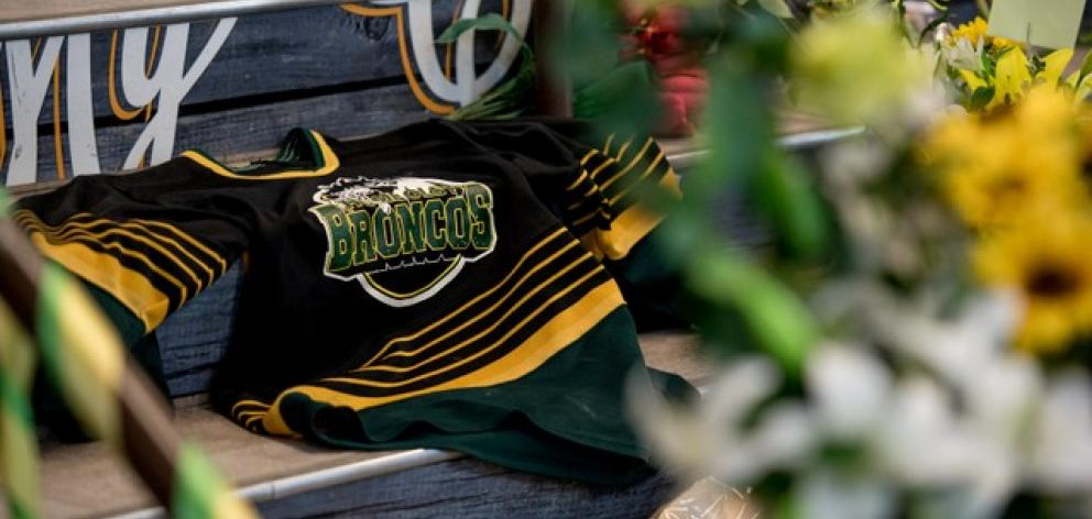 A Humboldt Broncos team jersey is seen among notes and flowers at a memorial for the Humboldt Broncos team. Photo: Reuters