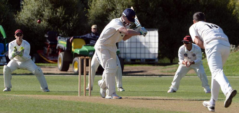 Otago batsman Jimmy Neesham lets a delivery from Canterbury bowler Andrew Ellis go through to...
