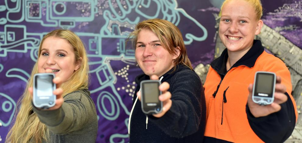 Diabetes research project participants Olivia Larkins (17), Brad England (17) and Brooke Helms ...