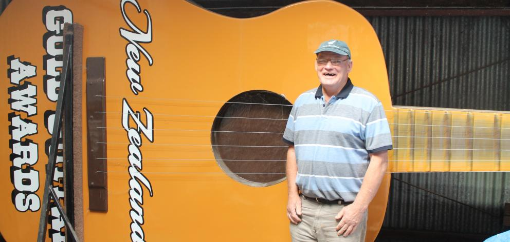 Gore Country Music Club member Alan Ritchie stands with the giant guitar that has been on display during past MLT New Zealand Gold Guitar Awards events. PHOTO: MARGARET PHILLIPS