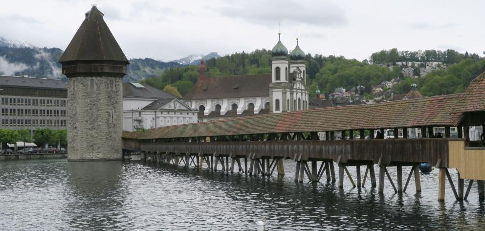 One of Lucerne's most famous sites is the Kapellbrucke, a covered wooden footbridge over the...