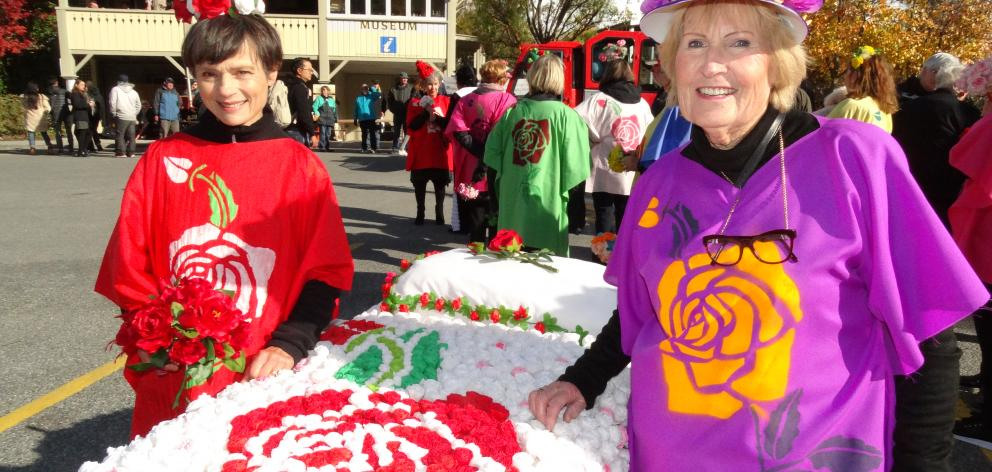 Helen Paterson (left) and Helen Hay display  their bed of roses at the Arrowtown Autumn Festival....