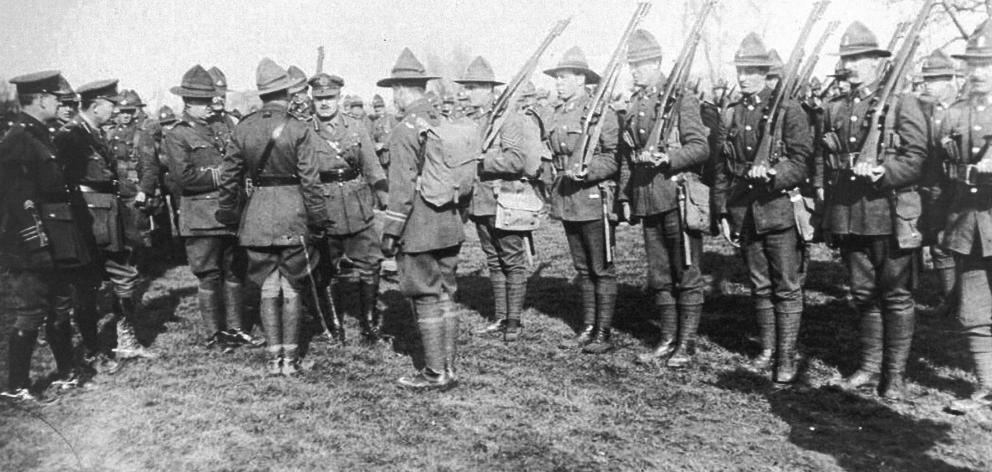 The officer commanding the New Zealand Division, Sir Andrew Russell (centre), is about to inspect...