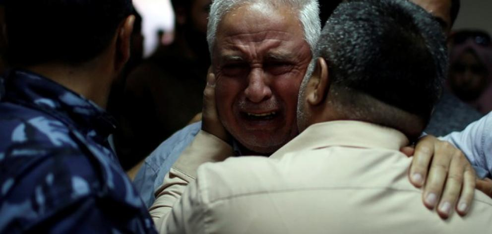 Relative of Palestinian Ahmed al-Rantisi, who was killed during a protest at the Israel-Gaza border, is consoled at a hospital in the northern Gaza Strip. Photo: Reuters/Mohammed Salem