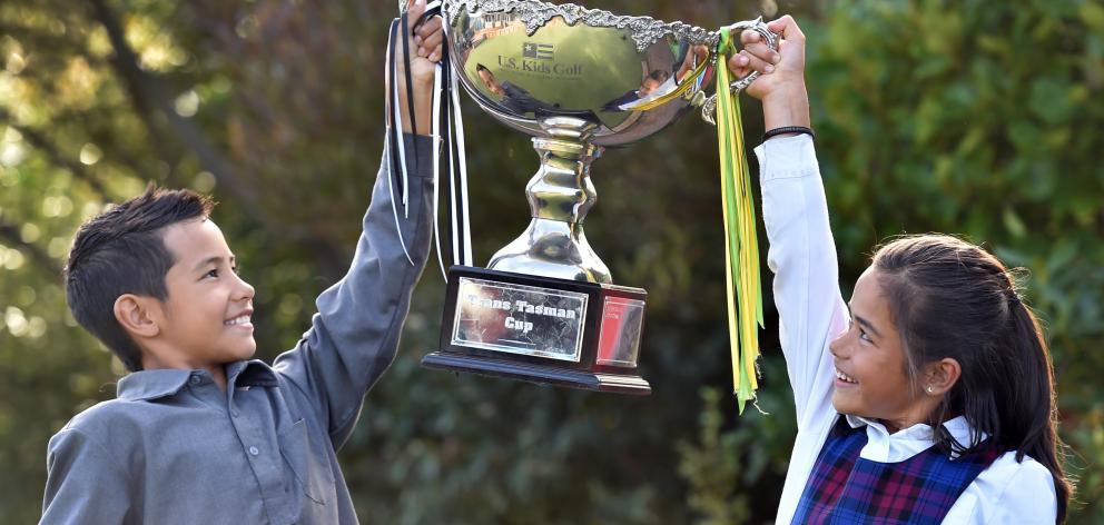 Kairangi (9) and Anahera Koni (8) hold aloft the transtasman trophy they helped win. Photo: Peter McIntosh