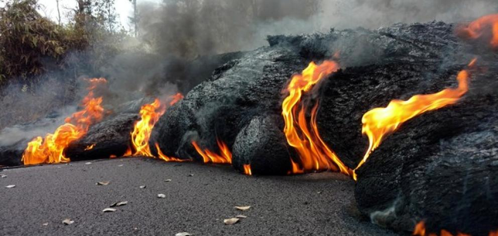 A lava flow is seen on a road in Pahoa