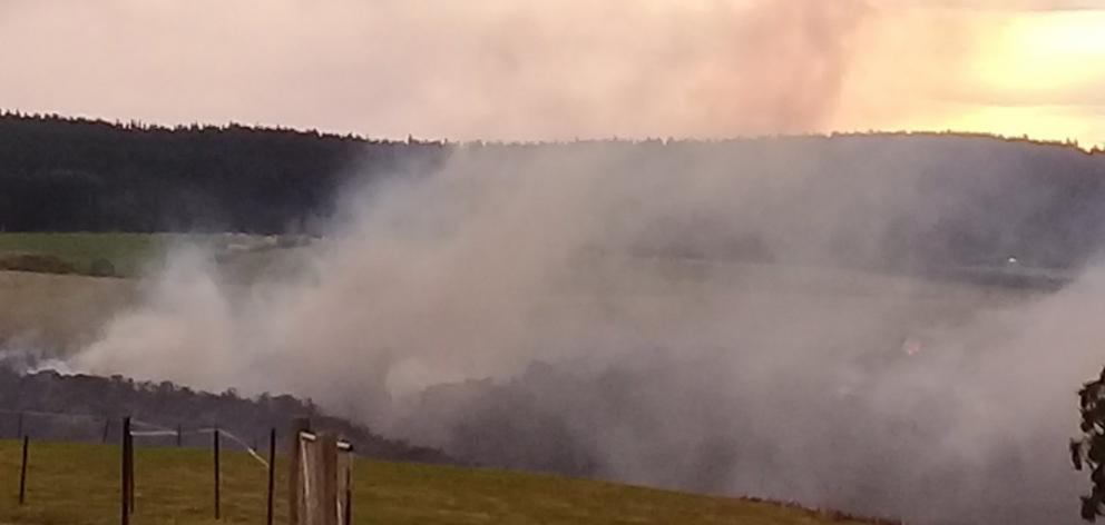 Smoke rises from a bush and gorse fire in a gully near Dicksons Rd north of Kuri Bush yesterday ...
