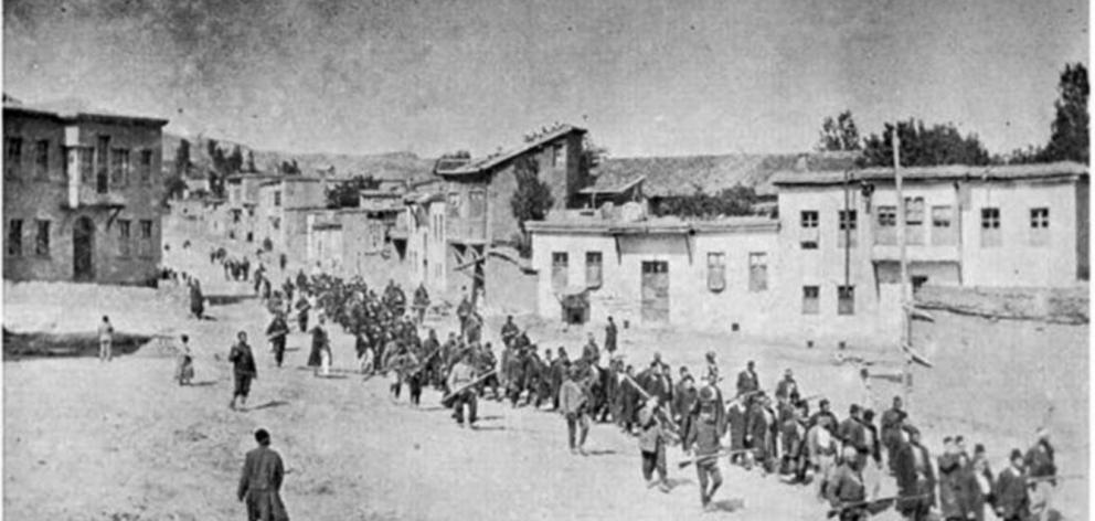Armenian civilians are marched by armed soldiers to an Ottoman Empire prison in April 1915. PHOTO...