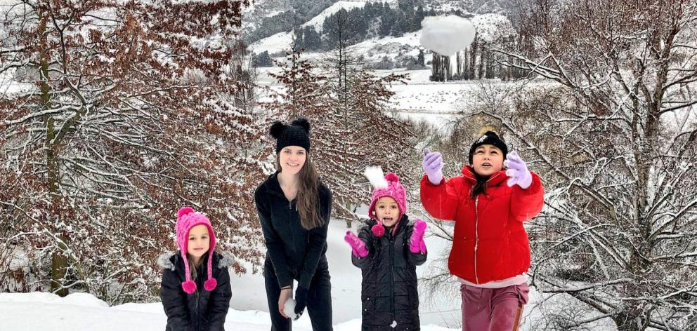Liz Dotcom plays in the snow with three of Kim's children at the Dotcoms' new home near...