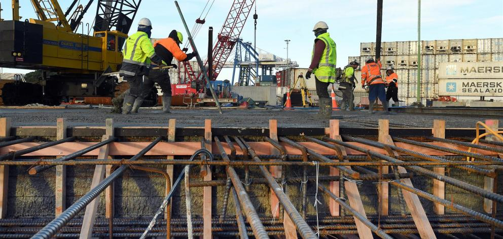 Concrete placers and finishers at Port Otago put the finishing touches on the latest wharf concrete pour yesterday. Photo: Stephen Jaquiery