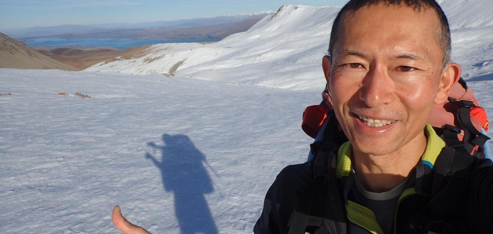 Eiji Kitai on Stag Saddle, Te Araroa's highest point, near Lake Tekapo. Photo: Eiji Kitai