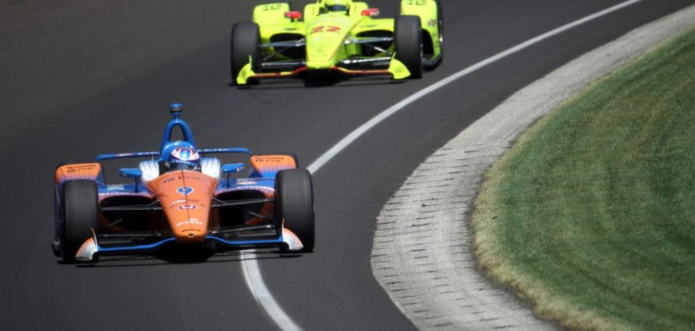 Scott Dixon rounds a corner at this morning's Indy 500. Photo: Getty Images