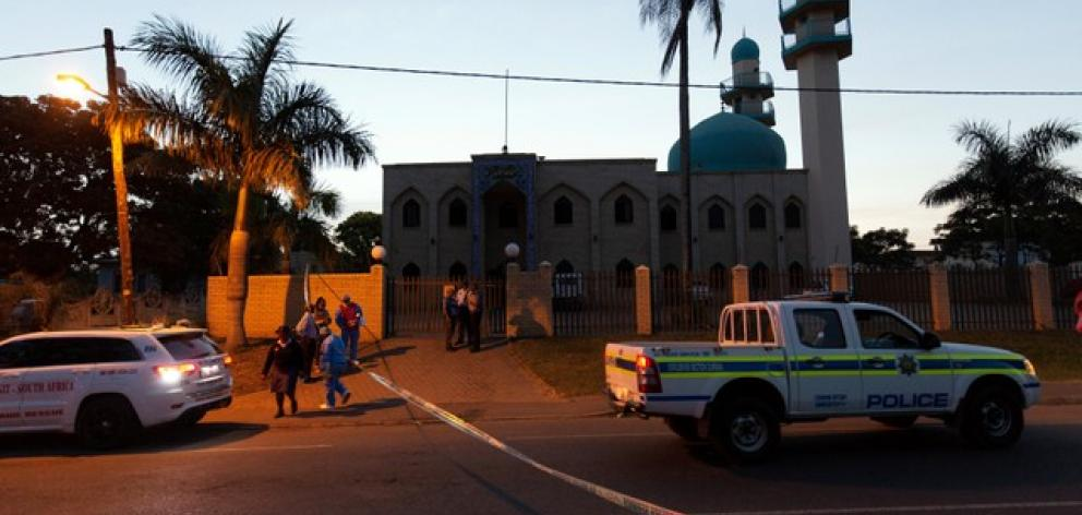 Police investigators collect evidence at a mosque where three men where attacked in Ottawa, South Africa. Photo: Reuters