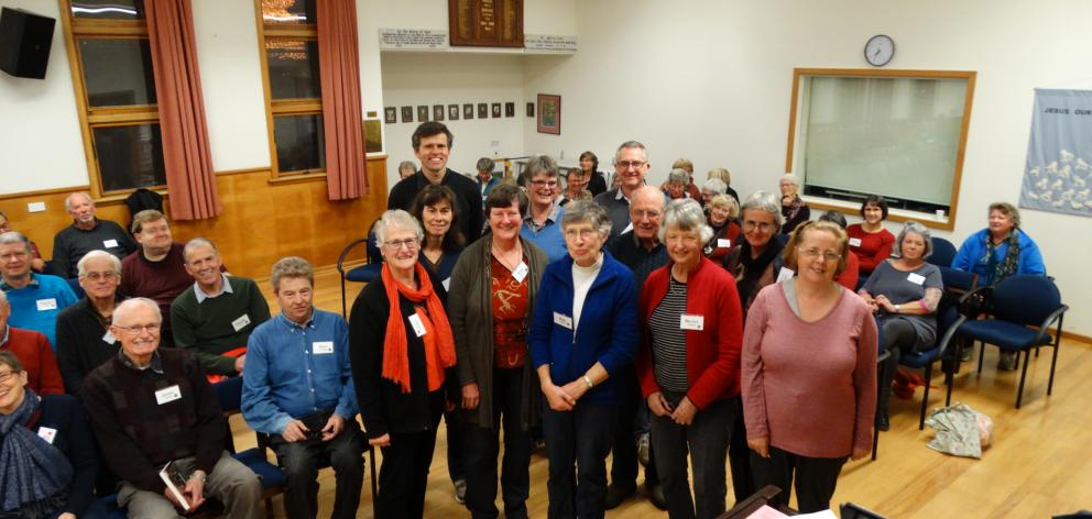 Choir director David Burchell (standing back left) gathers with some of the 30 members (also standing) of City Choir Dunedin who will travel to London to perform Anthony Ritchie's Gallipoli to the Somme, during Tuesday night's choir rehearsal ahead of the