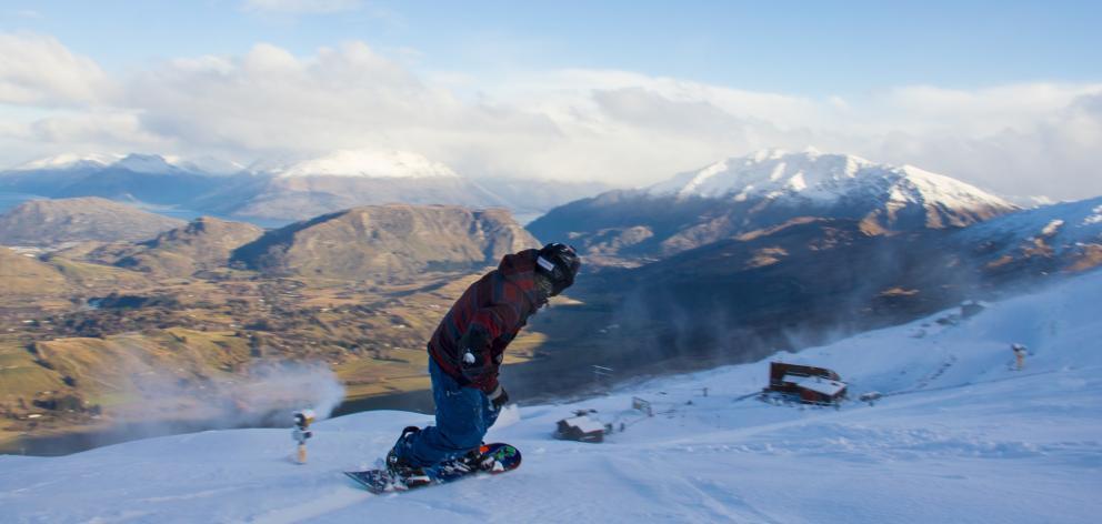 A snowboarder enjoys the new snow on the slopes of Coronet Peak skifield. PHOTO: NZSKI