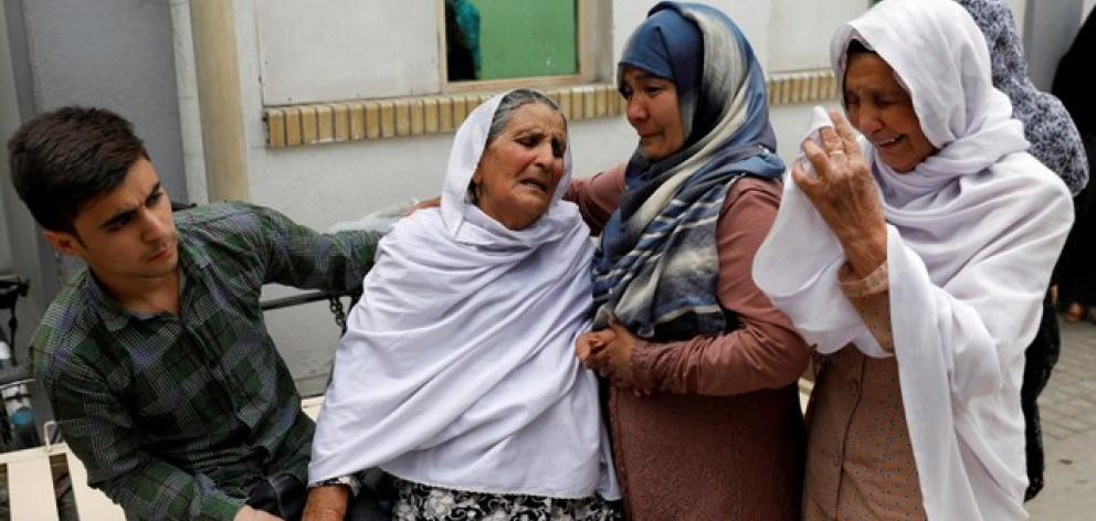 Relatives of the victims mourn at a hospital after a suicide attack in Kabul. Photo: Reuters
