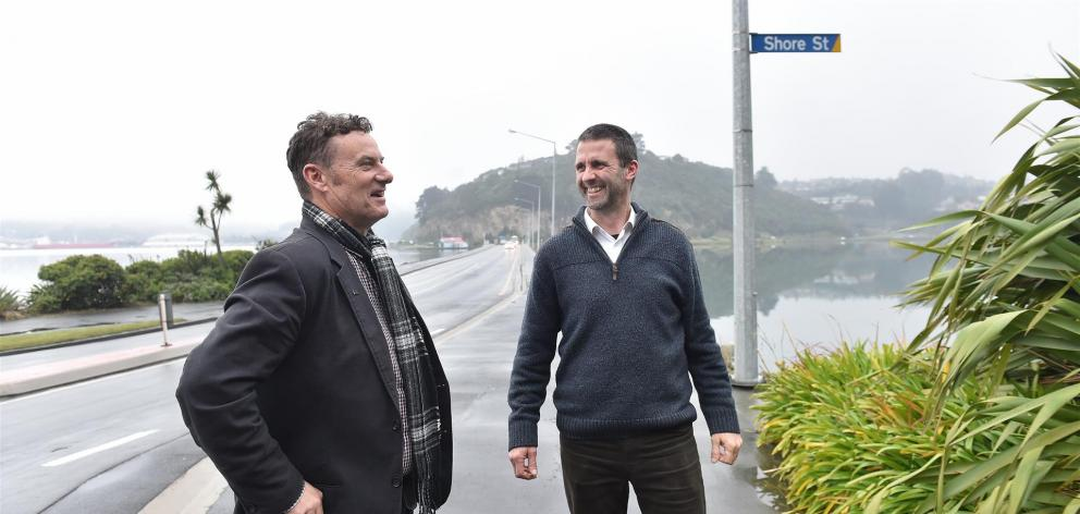Otago Peninsula Community Board chairman Paul Pope (left) and concerned parent Jason Graham at the start of the new route some peninsula buses will take. Photo: Peter McIntosh