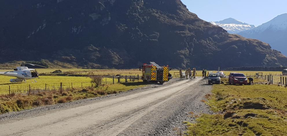 Emergency services attend the fatal crash scene on Mount Aspiring Rd in the Matukituki Valley,...