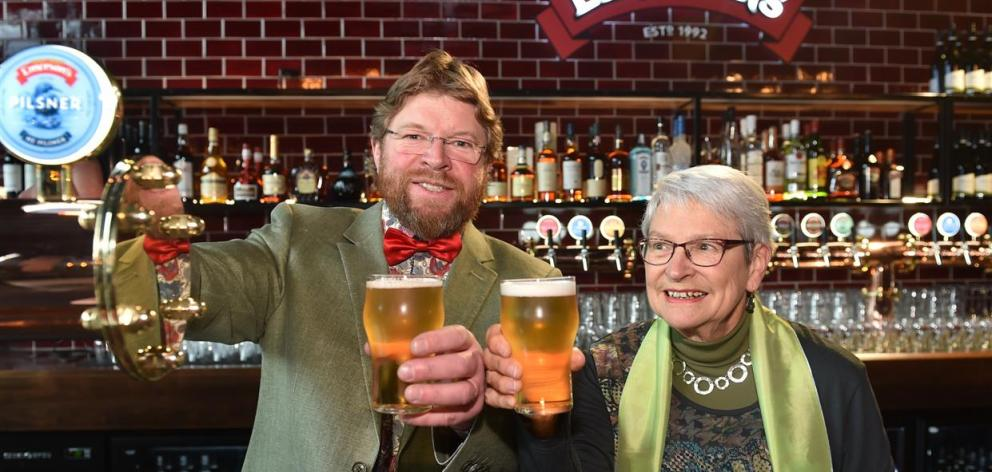 Emerson's founder Richard Emerson and his mother, Ingrid, raise a glass at the opening of the new...