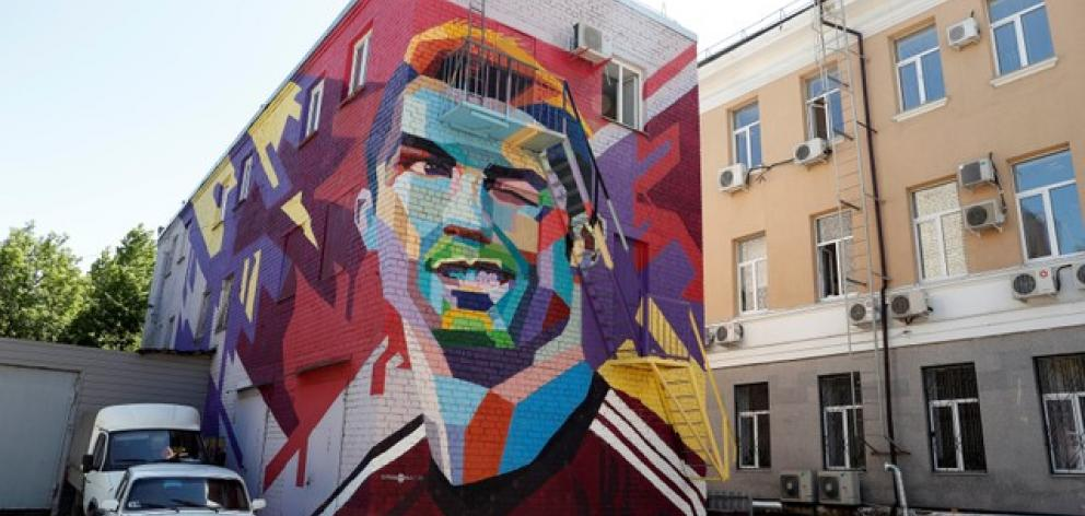 A mural of Portugal's Cristiano Ronaldo, painted in a courtyard in front of a hotel in Kazan, Russia. Photo: Reuters