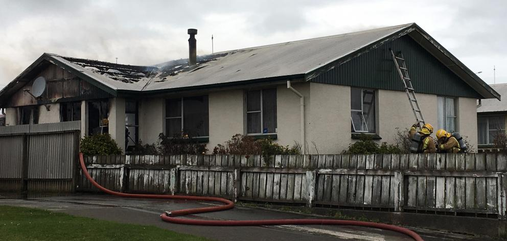 Three fire crews were called at 2.13pm to a blaze raging at a home in Centre St, near Glenalmond Cres, Invercargill. Photo: Sharon Reece