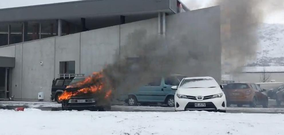 A car caught fire at a dealership in Queenstown today. Photo: James Allan