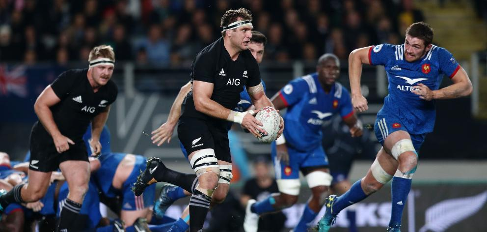 All Black No8 Luke Whitelock runs with the ball  Gabrillagues looks to cover.  with flanker Sam...