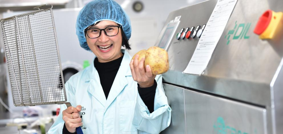 Professor Indrawati Oey of the Otago University Department of Food Sciences with the new PEF machine where potatoes go through and are made into chips. Photo: Peter McIntosh