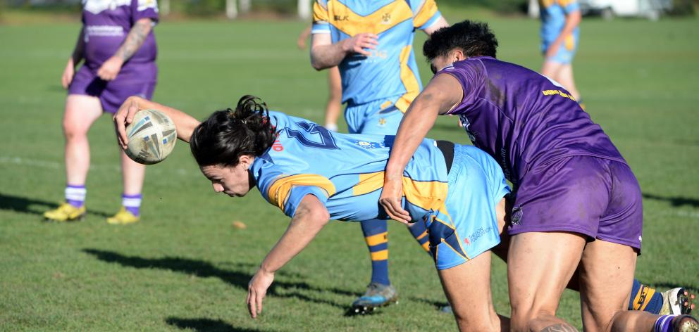 University's Matt Nicolson scores as he is tackled by Steven Campbell-Paniona, of South Pacific...
