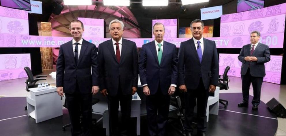 Presidential candidates pose for a group photo during their third and final debate in Merida. Photo: National Electoral Institute via Reuters