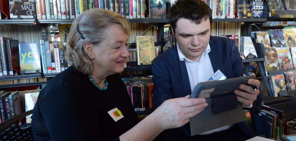 Clare Reilly, of Waitati, learns about her tablet from Otago Polytechnic information technology...