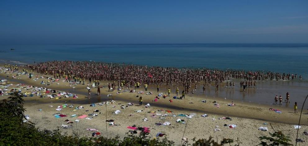 2505 women break a Guinness World record for the largest number of people skinny dipping together on Magheramore beach near Wicklow. Photo: Reuters
