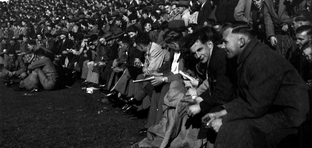 Crowds wait for kick-off at the 1948 rugby final between East and West Dunedin. Photos: Evening Star