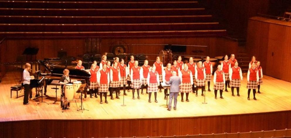 Conductor John Buchanan leads the Dunstanza Senior Girls' choir with accompanist Sharon McLennan ...