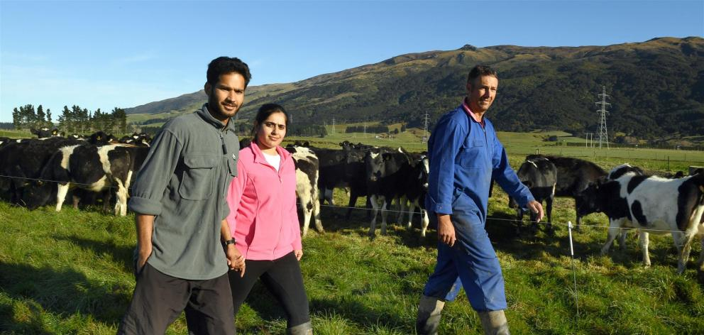 Herd manager Harrie Chander can stay in New Zealand but Immigration New Zealand wants to send his wife, Pawandeep, a nurse, back to India. Mr Chander works for Taieri farmer Mark Adam (also pictured). Photo: Stephen Jaquiery