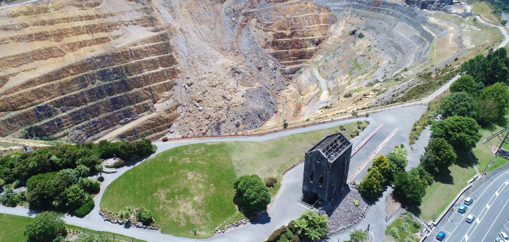 The historic Martha pit next to Waihi township, and the landslip which closed the pit operations...