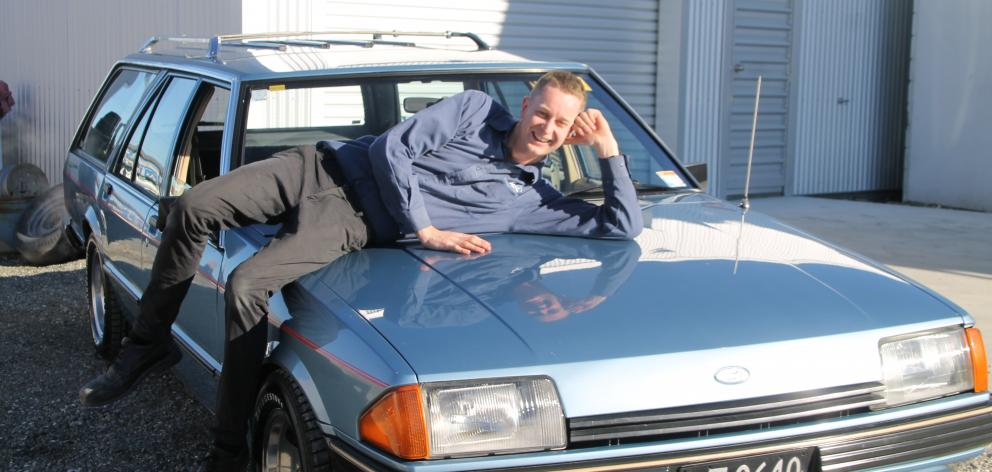 Motoring enthusiast Johnny Dennis and his 1983 Ford Falcon XE wagon. Photo: Ashleigh Martin